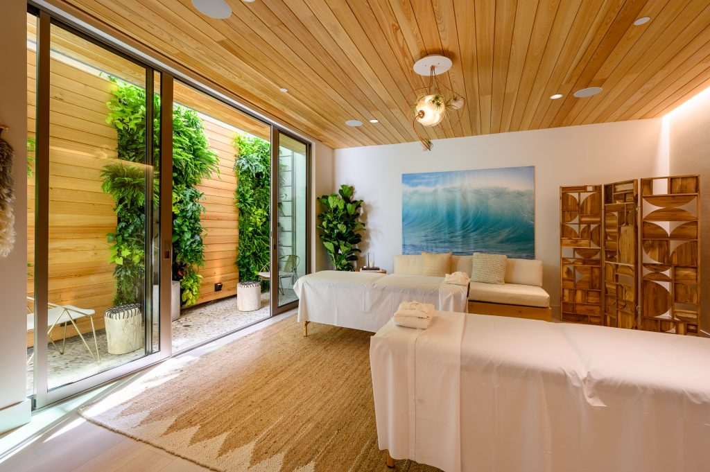 massage room with wood panels