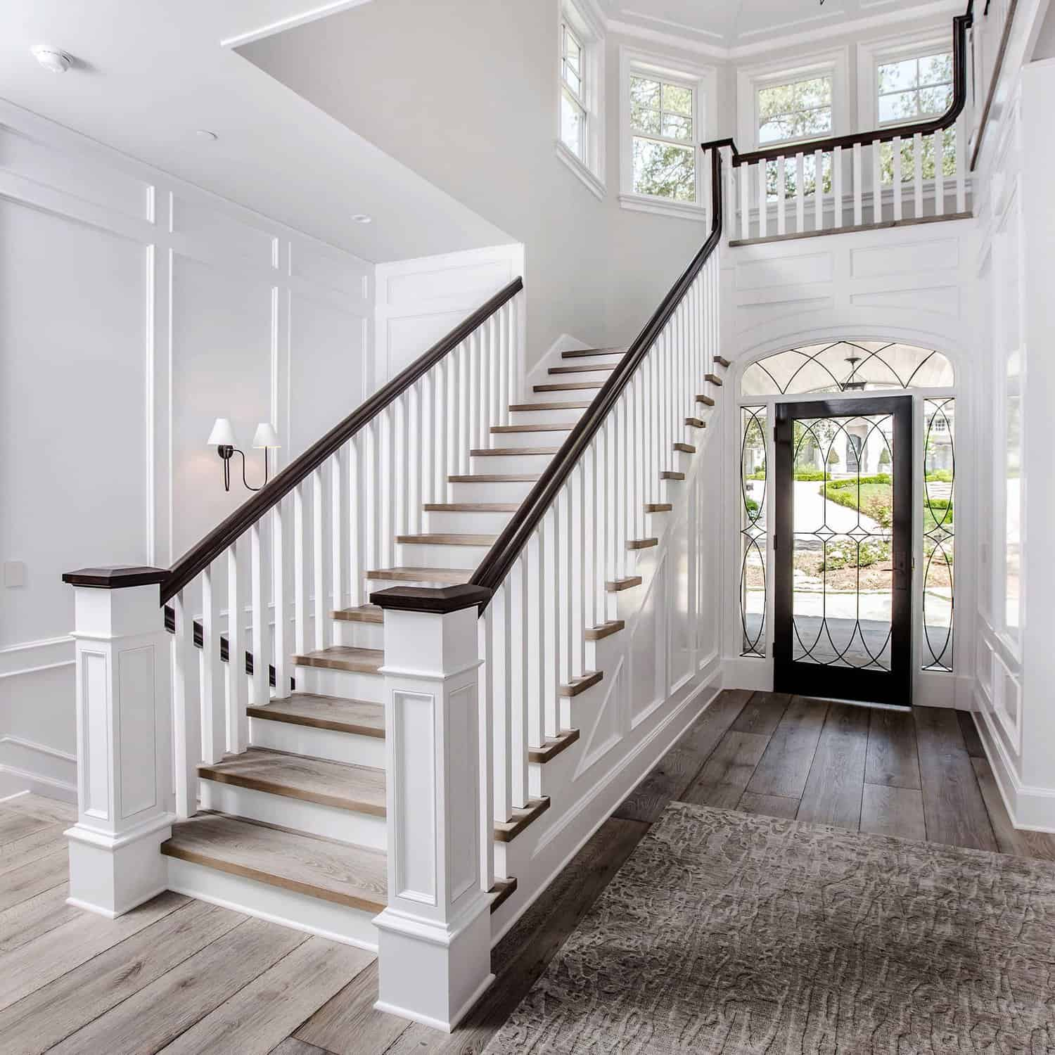 Beautiful White Staircase with Dark Wood Flooring