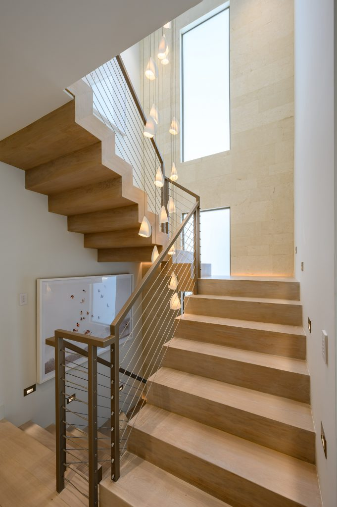 floating wood stairs with light decor
