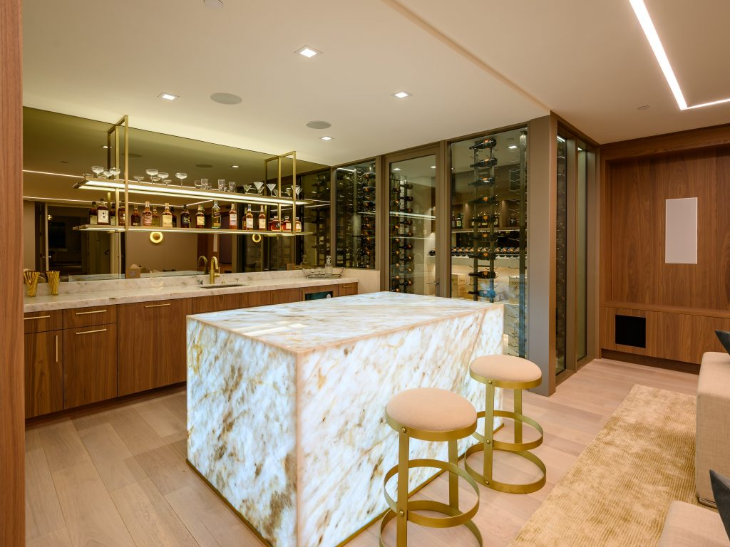 in-home bar of million dollar beach home featuring a unique square marble counter